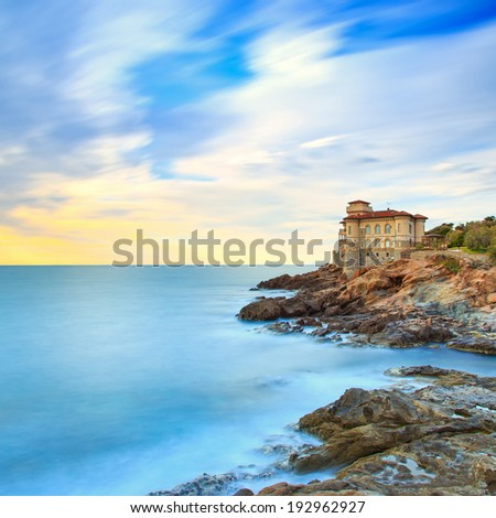 Boccale castle landmark on cliff rock and sea on sunset. Tuscany, Italy, Europe. Long exposure photography. - stock photo