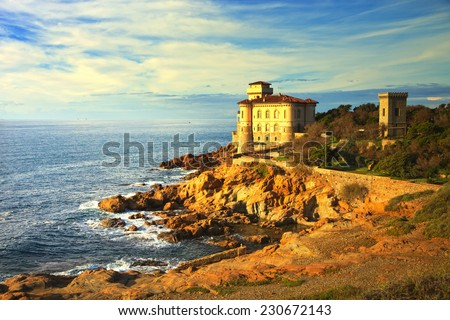 Boccale castle landmark on cliff rock and sea on warm sunset. Tuscany, Italy, Europe. - stock photo