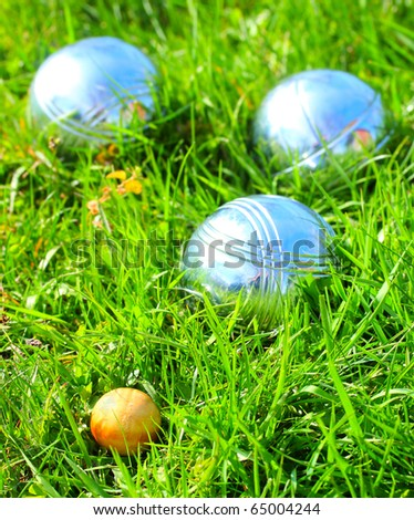 Bocce ball on a green grass. Close up with shallow dof. - stock photo