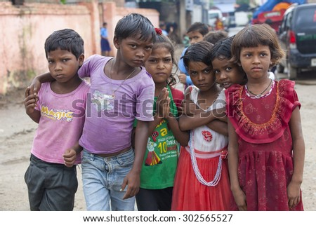 Bodh Gaya, India - July 10, 2015: Curious group of young children in a Goa looking curious into the camera. Bodh Gaya, India. Children Wide Angle Group Portrait. - stock photo