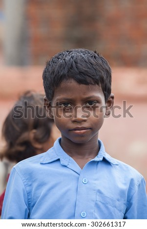Bodh Gaya, India - July 10, 2015: young children in a Goa looking curious into the camera. Bodh Gaya, India.  - stock photo