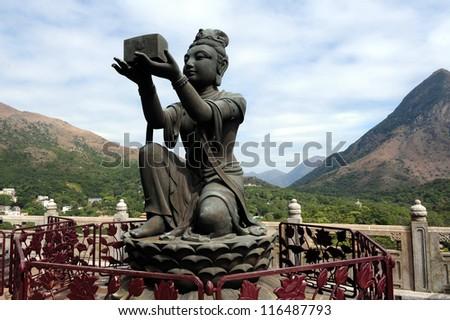 Bodhisattva offering gift to Buddha - from Tian Tan Buddha Lantau Island, Hong Kong, China - stock photo