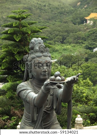 Bodhisattvas offering meals and objects to Buddha - stock photo