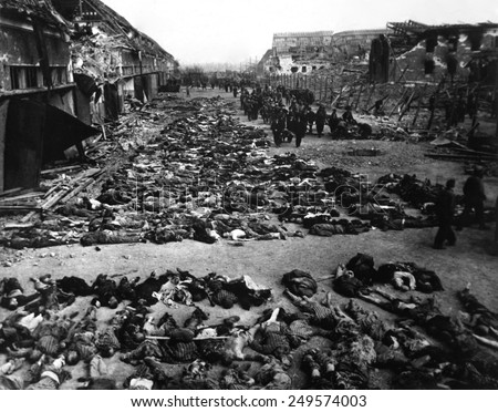 Bodies of dead inmates fill the yard of Nordhausen, a Gestapo concentration camp. Photo was taken shortly after the camp's liberation by U.S. Army. April 12, 1945, Germany, World War 2. - stock photo