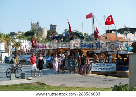 BODRUM, TURKEY - JULY 15, 2013: Tourist attractions in Bodrum during summer, people walking and shopping. - stock photo