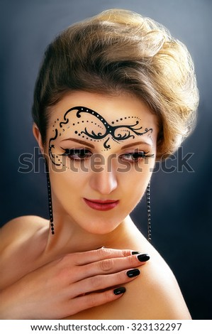 Body art on the face of the girl - stock photo