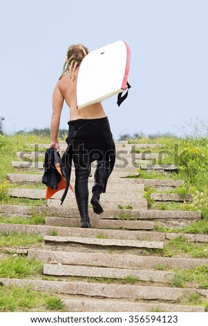 body boarder  men  in the stairway to the beach - stock photo