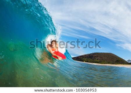 Body Boarder Surfing Blue Ocean Wave - stock photo