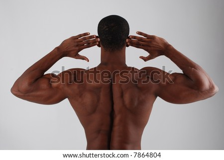 Body builder muscle back - stock photo
