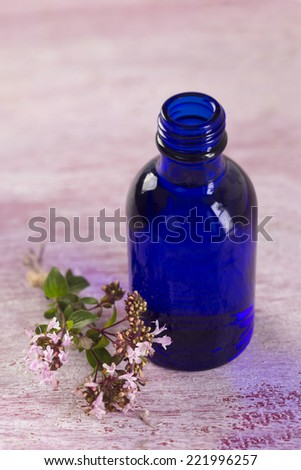 body-care and health-care essential oil of oregano - stock photo