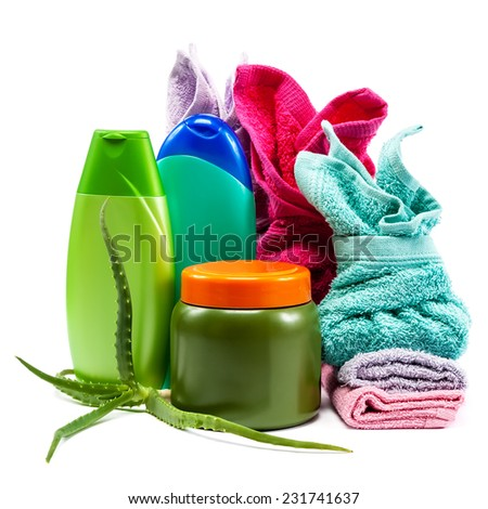 Body Care. Shampoo, soap, conditioner and towels stacked isolated on a white background. - stock photo