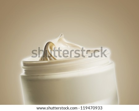 body cream on a colored background - stock photo