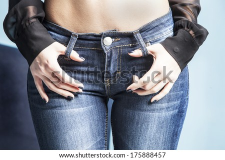 body in jeans, studio shot - stock photo