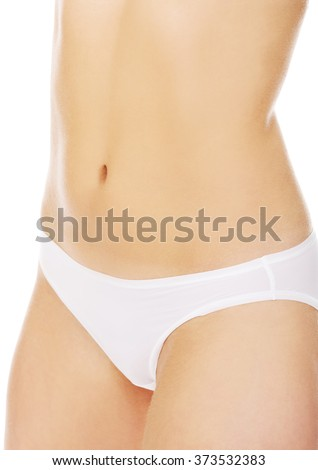 Body of slim young woman in white underwear - stock photo