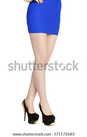 Body part, Woman legs with black heels isolated on white background - stock photo