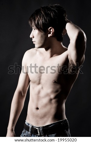 body profile of a muscular hunky asian man - stock photo