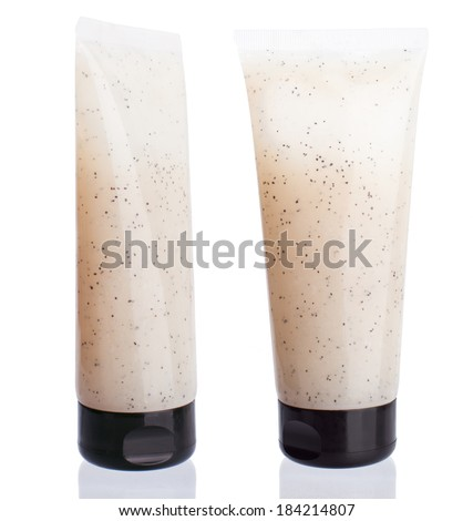 Body scrub in a tube on a white background without people. For care of a body, peels dead cells of skin, clears, rejuvenates. - stock photo