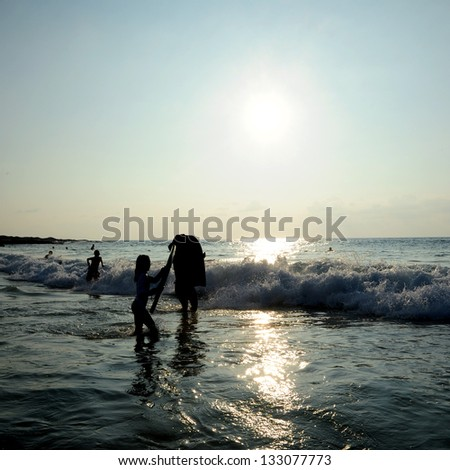 Body Surfers at Sunset - stock photo