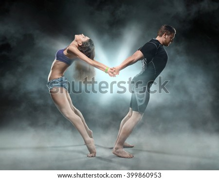 body workout, yoga and fitness - a beautiful young sporty couple a man and a woman - stock photo