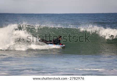 bodyboarder in the wave - stock photo