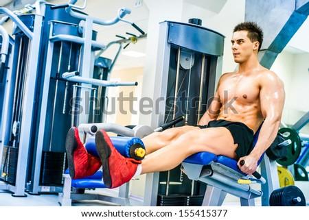 bodybuilder doing exercises on Leg - stock photo