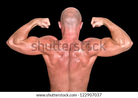 bodybuilder dorsal on black background - stock photo