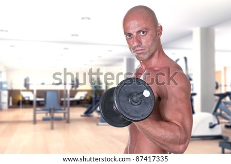 bodybuilder dumbbell at the gym - stock photo
