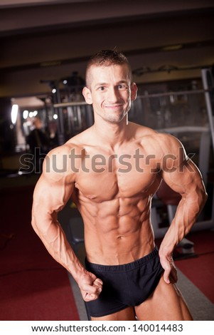 bodybuilder flexing - stock photo