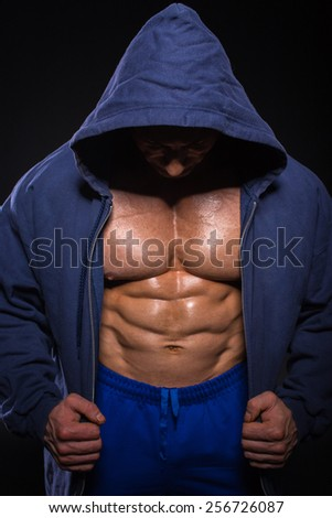 Bodybuilder is posing, showing his muscles. Force, relief, muscle, courage, virility, bodybuilder, bodybuilding. - stock photo