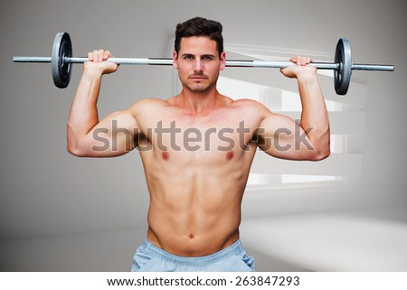 Bodybuilder lifting barbell against digitally generated room with bordered up window - stock photo