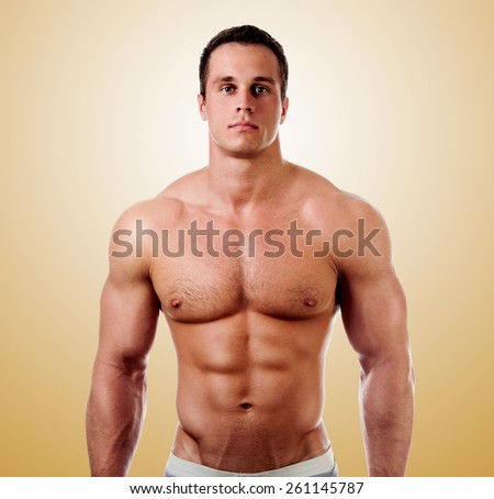 bodybuilder posing. Handsome power athletic guy male. Fitness muscular body.  - stock photo
