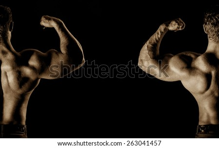 bodybuilder posing. Handsome power athletic guy male. Fitness muscular body on black background.  - stock photo