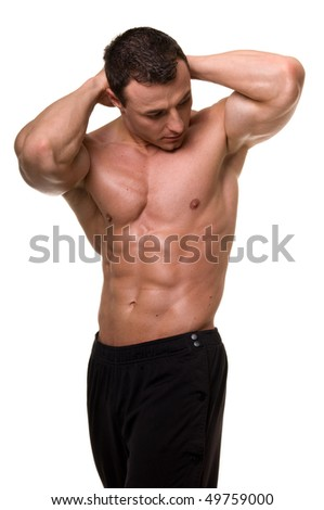 Bodybuilder posing on white background. - stock photo