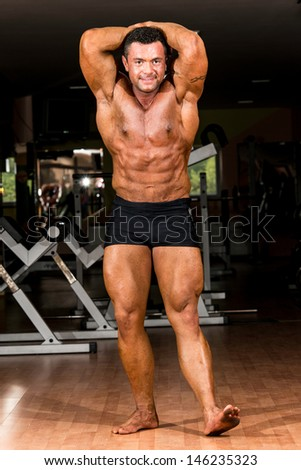 bodybuilder showing his front abdominal abs - stock photo