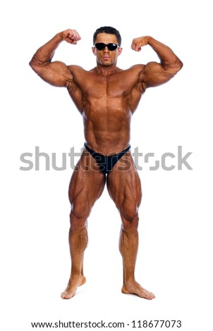 Bodybuilder showing his muscles on a white background.In glasses - stock photo