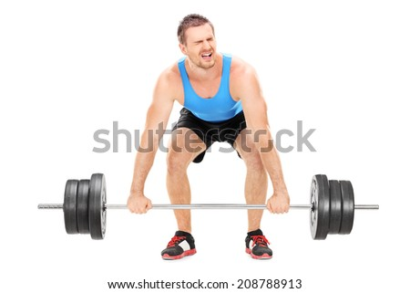 Bodybuilder struggling to lift a barbell isolated on white background - stock photo
