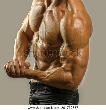 Bodybuilder topless, flexing his biceps. Strong man with perfect abs, shoulders,biceps, triceps and chest. Isolated on white background - stock photo