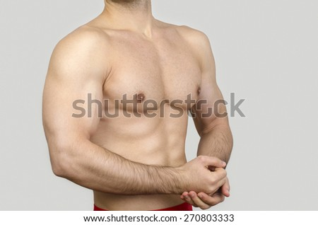 Bodybuilder topless, showing his muscles. Unrecognizable strong man with perfect abs, shoulders,biceps, triceps and chest. - stock photo