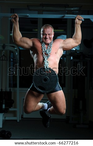 Bodybuilder training hard in gym - stock photo