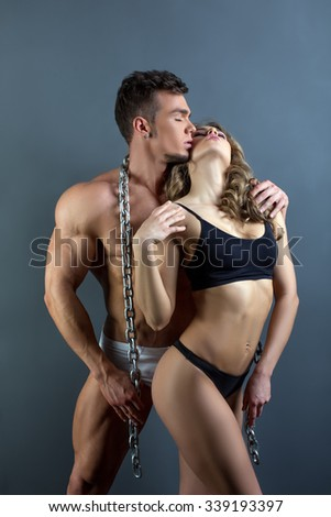 Bodybuilding. Male power and female sensuality - stock photo
