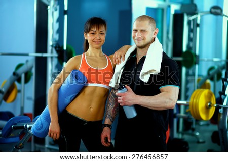 Bodybuilding. Strong man and a woman posing  - stock photo