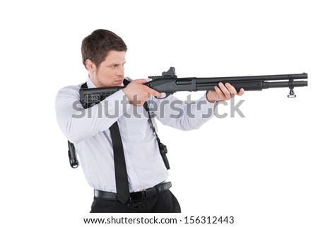 Bodyguard. Side view of confident young man in shirt and tie aiming with the gun and looking at camera while standing isolated on white - stock photo