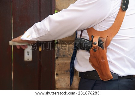 Bodyguard with gun opens the door - stock photo