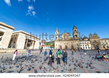 BOGOTA, COLOMBIA - APRIL 21: View of activity in the Plaza de Bolivar in front of the Cathedral and the Supreme Court in Bogota, Colombia on April 21, 2016 - stock photo