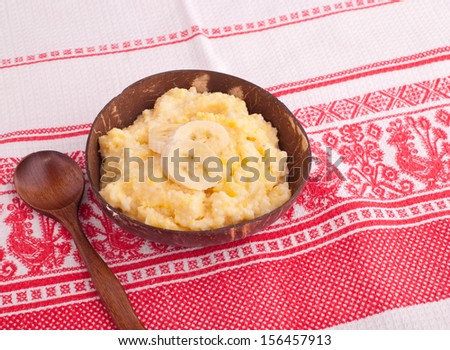 boiled Corn Porridge with banana and spoon - stock photo