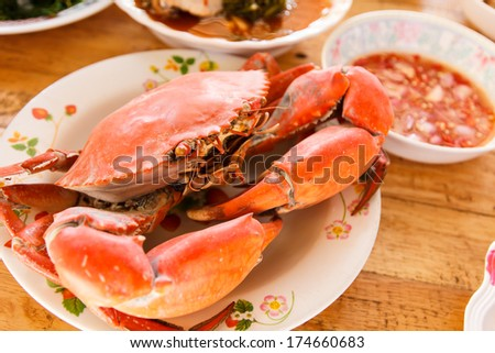 Boiled crab prepared on plate on wooden background-2 - stock photo