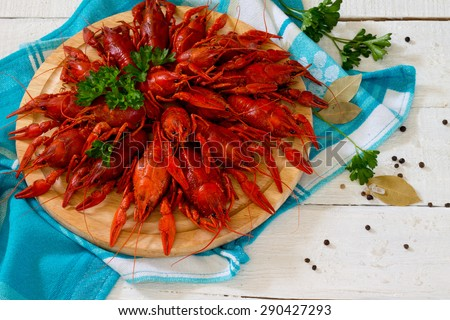 Boiled crayfish with parsley - stock photo