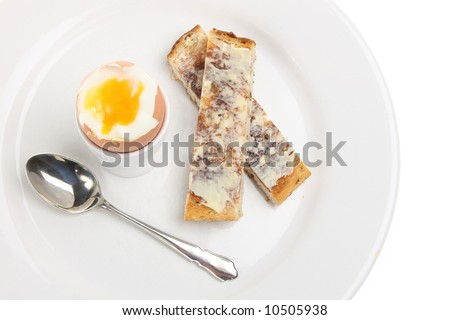 Boiled egg with toast soldiers - stock photo