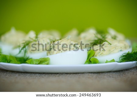 boiled eggs stuffed stuffed with greens on a plate - stock photo