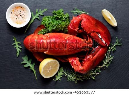Boiled lobster on black slate plate - stock photo